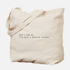 Don't ask me. I'm just a medical student. Tote Bag