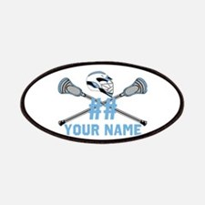 Lacrosse sticks crossed with helmet columbia blue