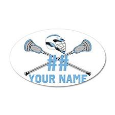 Lacrosse sticks crossed with helmet columbia blue