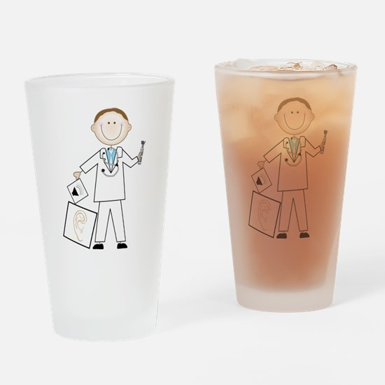 Male Audiologist Drinking Glass
