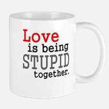 Love is being stupid together Mug