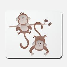 Cartoon monkeys hanging around Mousepad