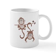 Cartoon monkeys hanging around Mug