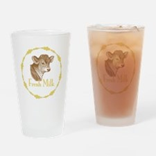 Fresh Milk with Baby Cow Drinking Glass