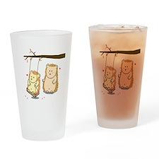 Cute Cartoon Hedgehog couple at tree swing Drinkin