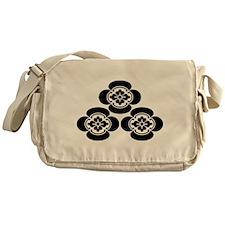 Pile of three mokko Messenger Bag