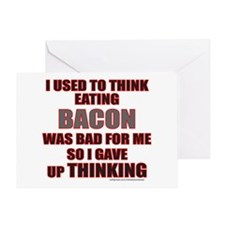 EATING BACON Greeting Card