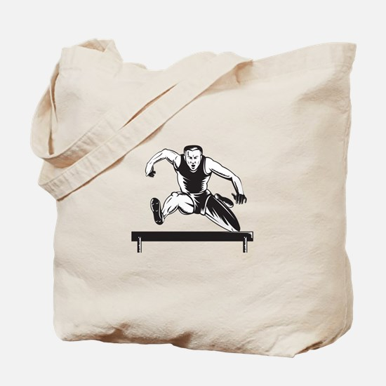 Track and Field Athlete Jumping Hurdles Tote Bag