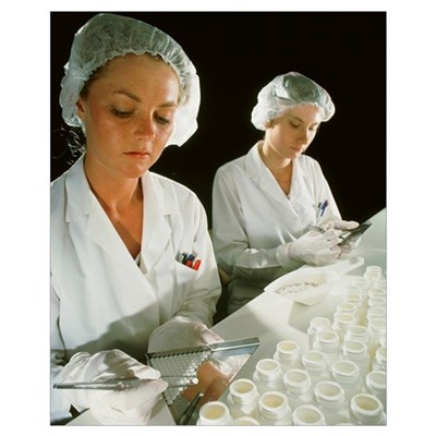Female technicians counting pills into a bottle Poster