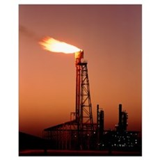 Gas flare in front of an oil refinery Poster