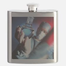 Chemist holding a round bottomed flask - Flask