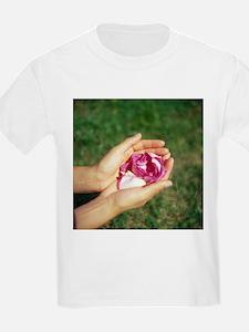 Flower held in hands - T-Shirt