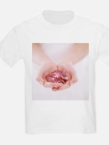 Petals held in hands - T-Shirt