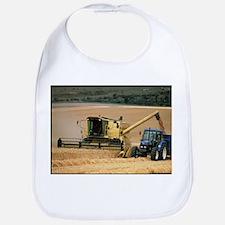 Combine harvester off-loading grain - Bib