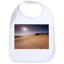 Footprints over sand dunes - Bib