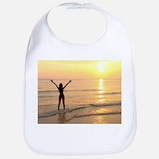 Woman standing in the sea - Bib
