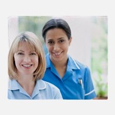 Nurses smiling - Throw Blanket