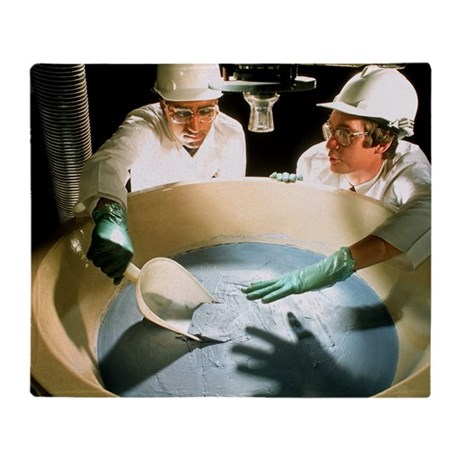 Technician monitoring pharmaceutical production -