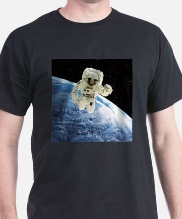 Composite image of a spacewalk over Earth - T-Shirt