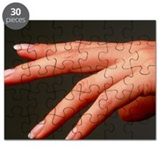 Side view of the healthy hand of a woman - Puzzle
