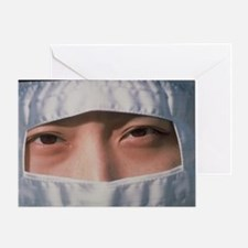 Pharmaceutical technician in clean room clothing -