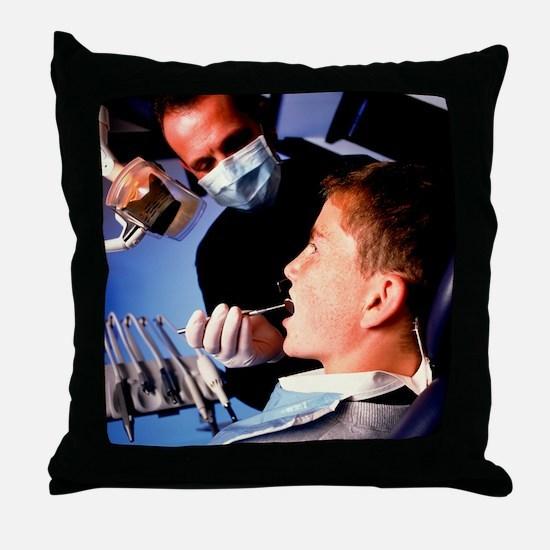 Dentist examining a boy's mouth - Throw Pillow
