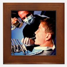 Dentist examining a boy's mouth - Framed Tile