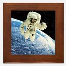 Composite image of a spacewalk over Earth - Framed