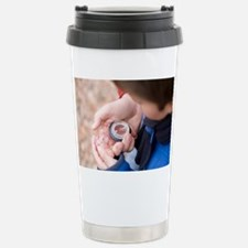 Father and son reading a compass - Travel Mug