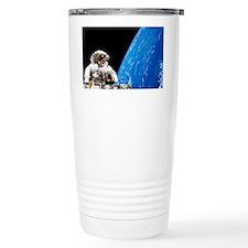 Astronaut performing a spacewalk - Travel Mug