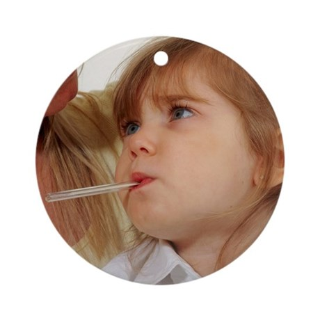 Young girl with fever has oral temperature taken -