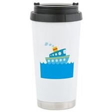 Boat in Blue Water Travel Mug