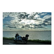 Beemer on dike with cloudy sky #1