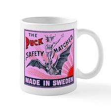 Puck Riding Bat Swedish Matchbox Label Pink Mug