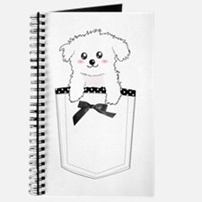 Cute puppy dog in pocket Journal