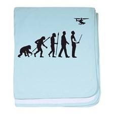 evolution of man with model helicopter baby blanke