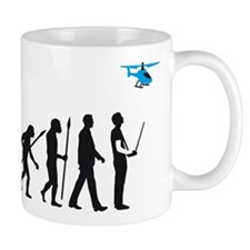 evolution of man with model helicopter Tasse