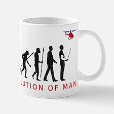 evolution of man with model helicopter Tasse