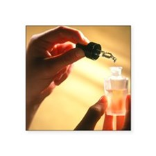 Hand creating an aromatherapy oil - Square Sticker