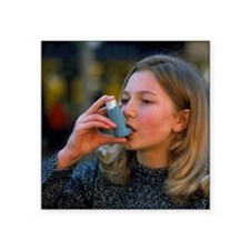 Teenager using an aerosol inhaler for asthma - Squ