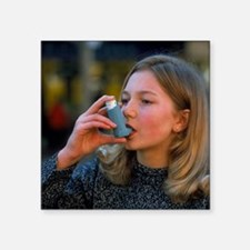 Teenager using an aerosol inhaler for asthma - Squ