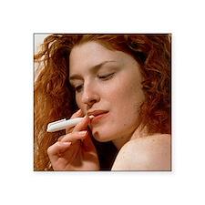 Woman uses a Nicorette nicotine drug inhaler - Squ
