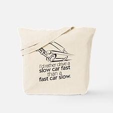 drive a slow car fast Tote Bag