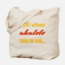 A day without Ukulele Makes me weak.. Tote Bag