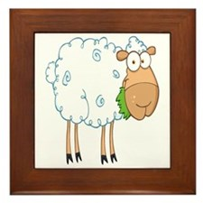 funky cartoon white sheep chewing grass Framed Til