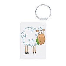 funky cartoon white sheep chewing grass Keychains
