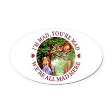 WE'RE ALL MAD HERE Oval Car Magnet