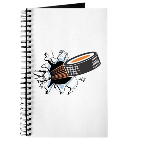Hockey Puck Rip Through Journal
