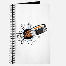 Hockey Puck Rip Through Journal