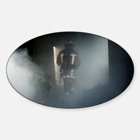 Fire fighter in a burnt house - Sticker (Oval)